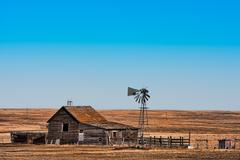 abandoned prairie homestead - stock photo