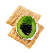 cool cucumber and caviar cracker - stock photo