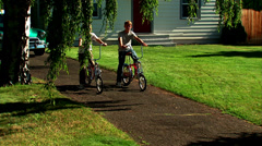 Kids on Bikes Dolley Forward Stock Footage
