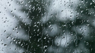 Stock Video Footage of Raindrops on window glass