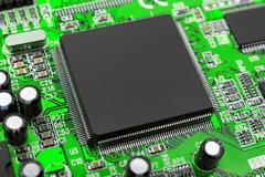 Macro of computer chip - stock photo