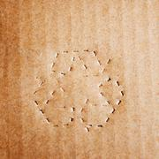 Green recycle symbol on cardboard Stock Photos
