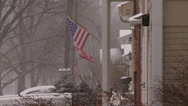 Stock Video Footage of American Flag in Neighborhood with Snow