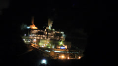NIGHT PAN OF A FACTORY IN THE MOUNTAINS Stock Footage