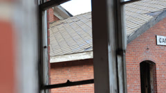 ABANDONED RAILROAD STATION PAN THROUGH WINDOWS - stock footage