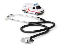 Stethoscope and toy ambulance car - stock photo