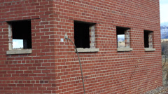 PAN OF AN ABANDONED OLD BRICK TRAIN STATION Stock Footage