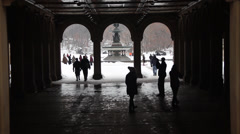 3 ARCH WALKWAY. WIDE SHOT. FOUNTAIN IN SNOW IN BACKGOUND - stock footage
