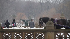 Horse carriages on old snow covered bridge. - stock footage