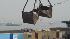 CONSTRUCTION DREDGING: Giant Shovel Drops into River Dredges out Sand Stock Footage