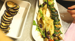 Arranging grilled vegetables on plate Stock Footage