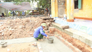 Stock Video Footage of group of builders working on the construction site