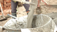 Stock Video Footage of Construction worker mixing concrete