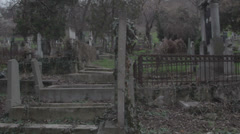 Old haunted cemetery [flycam] stumbling - stock footage