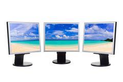 Panorama of beach on computer screens Stock Photos