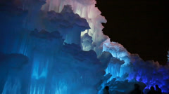 Crowds in frozen ice castle Stock Footage