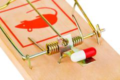 Mousetrap and pill - stock photo