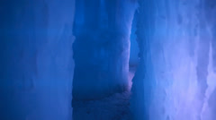 Walking through frozen ice castle Stock Footage