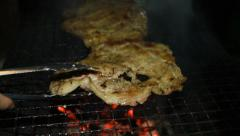 Pork steak on barbecue grill Stock Footage