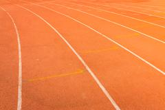 athletics track lanes with white line - stock photo