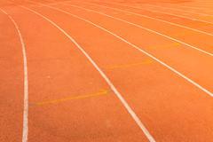 Athletics track lanes with white line Stock Photos