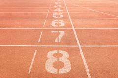 Athletics track lanes with white line Stock Photos