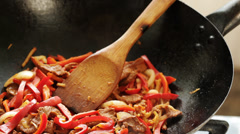 Beef and vegtable frying in wok - asian cuisine Stock Footage