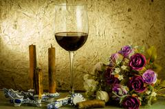 red wine and glass on a old paper background - stock photo