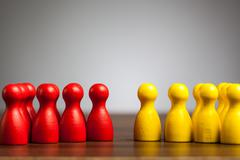 Opposition groups concept, toy pawn figures Stock Photos