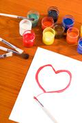 Valentine heart shape painting on white paper - stock photo