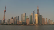 Stock Video Footage of Shanghai Pudong Skyline in the afternoon sun (41 degree celsius)