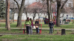 Children playing in the park with a ball,medium shot Stock Footage