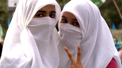 Two young girls in Burqa at Islamist Rally in Pakistan - stock footage