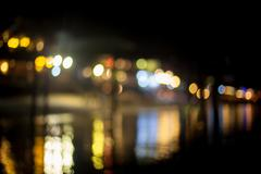 Blurred beach lights with bokeh effect - stock photo