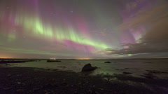 Brilliant aurora display over the ocean near Reykjavik, Iceland 4k Stock Footage