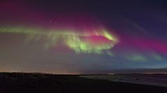 Brilliant aurora display over the beach near Reykjavik, Iceland 4K - stock footage