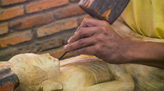 Cambodia, siem reap. carving buddha statue from a wood Stock Footage