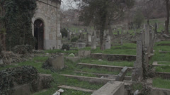 Old haunted cemetery [flycam] church entrance  Stock Footage