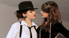 Two fabulous women are flirting with each other. Close Up. Stock Footage