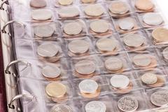 Coin album with world coins Stock Photos