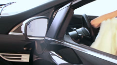 Enigmatic lady is posing in an automobile. Stock Footage