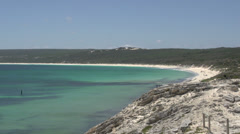 Pan from Yallingup Beach to island and boat in Margaret River, Western Australia Stock Footage
