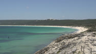 Stock Video Footage of Pan from Yallingup Beach to island and boat in Margaret River, Western Australia