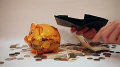 Hands putting money in wallet, piggy bank, coins and Euro banknotes, savings Stock Footage