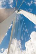 detail of erasmus bridge with blue sky in rotterdam, the netherlands - stock photo