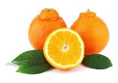 orange fruits with green leaves isolated on white background. - stock photo