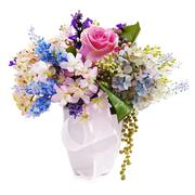 Bouquet from artificial flowers arrangement centerpiece in vase isolated  Stock Photos