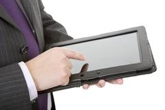 Stock Photo of businessman using touch pad, close up shot on tablet pc, isolated