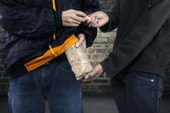 drug abuse transaction - stock photo