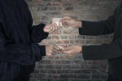 drug abuse transaction - stock photo
